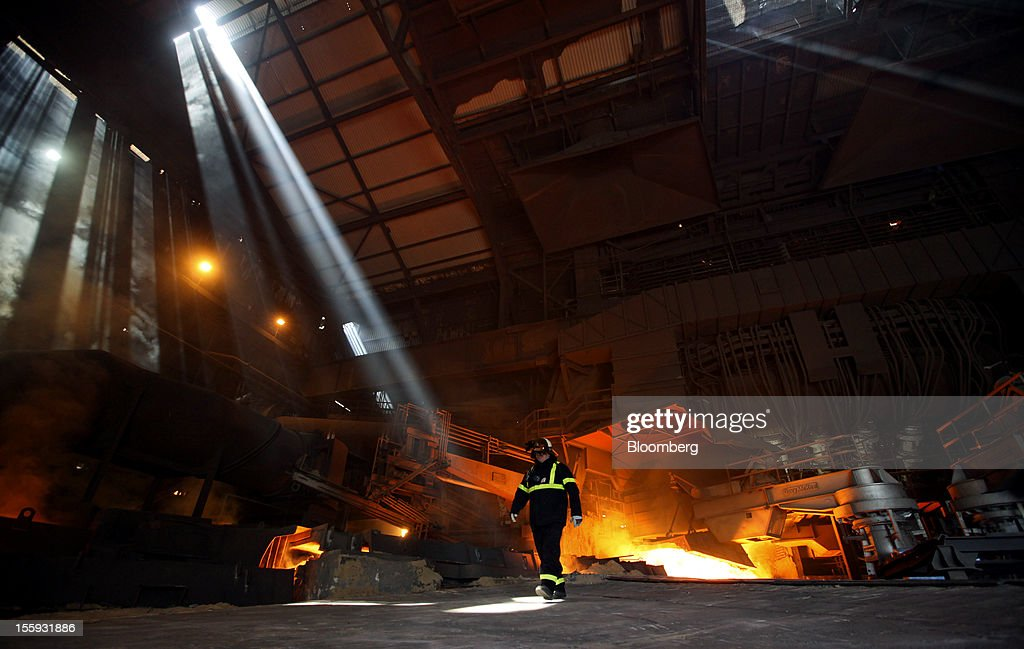 EDITORS' GUILD AWARDS 2012. One of the five photographs by Bloomberg photographer Chris Ratcliffe shortlisted for the 'Bloomberg Business Photographer of the Year' category in the 2012 awards. Picture Shows: An employee walks through the blast furnace room at the Sahaviriya Steel Industries Pcl (SSI) steel-making plant in Redcar, U.K., on Tuesday, May 29, 2012. Photographer: Chris Ratcliffe/Bloomberg via Getty Images
