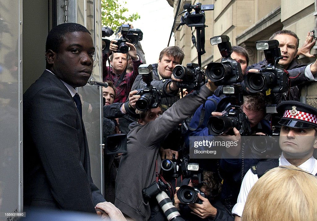 EDITORS' GUILD AWARDS 2012. One of the five photographs by Bloomberg photographer Simon Dawson shortlisted for the 'Bloomberg Business Photographer of the Year' category in the 2012 awards. Picture Shows: Kweku Adoboli, the UBS trader, left, is escorted from a prison van as he arrives at the City of London magistrates court in London, U.K., on Thursday, Sept. 22, 2011. Photographer: Simon Dawson/Bloomberg via Getty Images