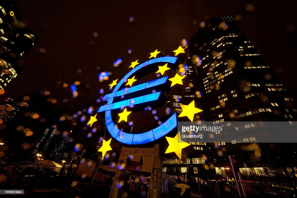 EDITORS' GUILD AWARDS 2012. One of the five photographs by Bloomberg photographer Simon Dawson shortlisted for the 'Bloomberg Business Photographer of the Year' category in the 2012 awards. Picture Shows: A Euro sign sculpture stands illuminated in front of the European Central Bank's (ECB) headquarters in Frankfurt, Germany, on Thursday, Dec. 29, 2011. Photographer: Simon Dawson/Bloomberg via Getty Images