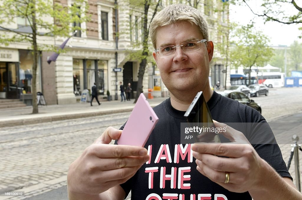 One of the founders of Jolla company, Sami Pienimaki, presents the new Jolla smartphone in Helsinki, on May 20, 2013. The phone uses Linux-based Sailfish operating system and it is compatible with Android applications. AFP PHOTO/ LEHTIKUVA / Kimmo Mantyla FINLAND OUT