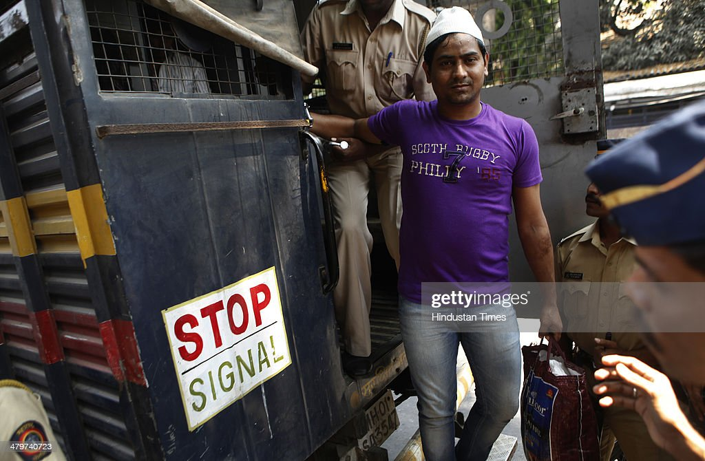 One of the four accused in Shakti Mill Rape case taken from Arthur Road Jail to Session court for final judgment on March 20, 2014 in Mumbai, India. Over seven months after the gangrape of two women including a photojournalist in the abandoned Shakti Mills compound in Mumbai, five persons were held guilty by a local court which will pronounce the quantum of punishment tomorrow.