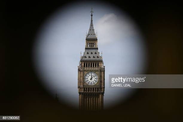 TOPSHOT One of the four faces of the Great Clock of the Elizabeth Tower commonly referred to as Big Ben is pictured at the Houses of Parliament in...