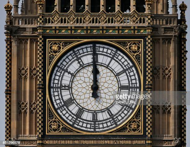 One of the four faces of the Great Clock of the Elizabeth Tower commonly referred to as Big Ben is pictured at the Houses of Parliament at midday in...