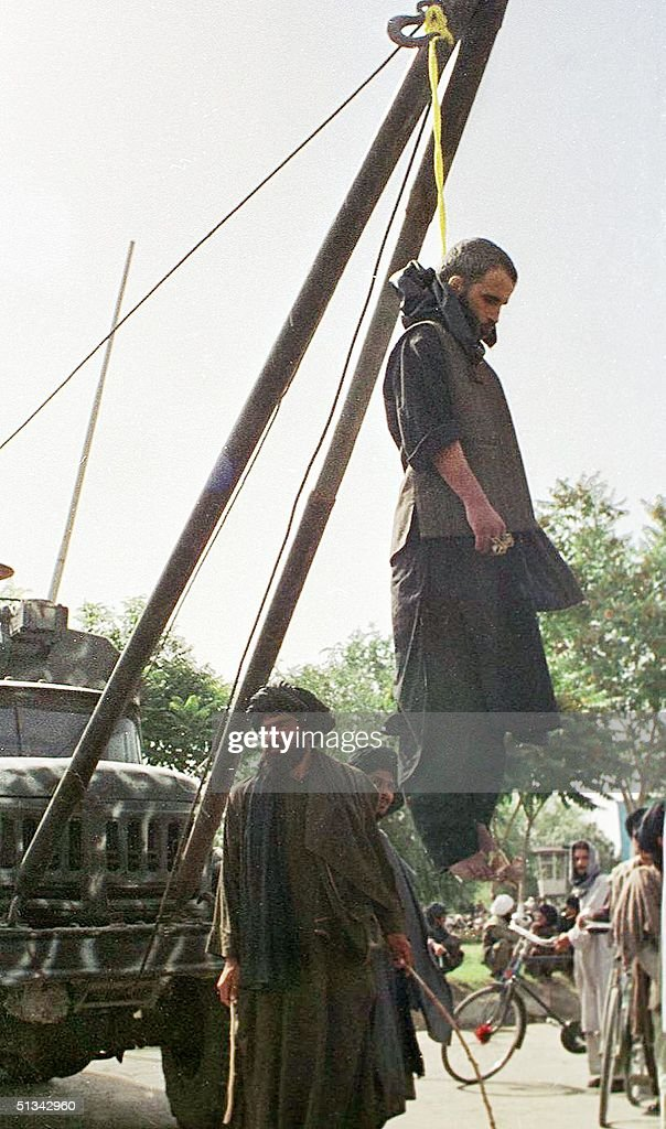 One of the four men executed by Taliban Islamic militia is left hanging in a makeshift gallows in Kabul 08 August 2001. Taliban chief Mullah Mohammad Omar ordered the four to be put to death for allegedly masterminding several bomb blasts in Kabul last year. The Taliban regime, which controls most of Afghanistan, has blamed supporters of opposition commander Ahmad Shah Masood for a spate of minor blasts which rocked the capital this year.