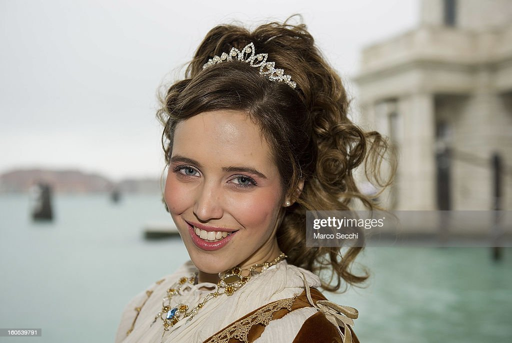 One of the girls impersonating the Marie pose while on a waterbus on the Grand Canal on February 2, 2013 in Venice, Italy. The traditional parade of '12 beautiful Venetian girls' which forms part of the Festa delle Marie and is an important part of the Venetian Carnival today had to be cancelled due to heavy rain.