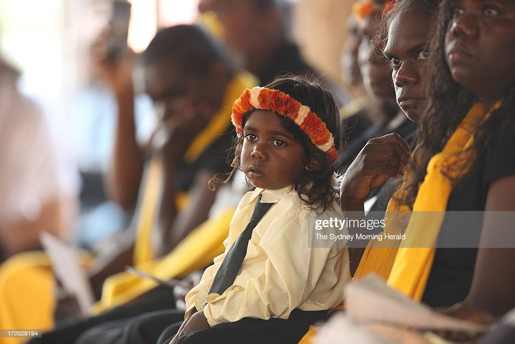 One of the grandchildren of the former lead singer of the band Yothu Yindi, educator and former Australian of the year, Mr Yunupingu attends his state memorial service on June 30, 2013 in Gulkula, Nhulunbuy in the Northern Territory, Australia. Former Yothu Yindi singer and indigenous educator Yunupingu died almost a month ago aged 56.