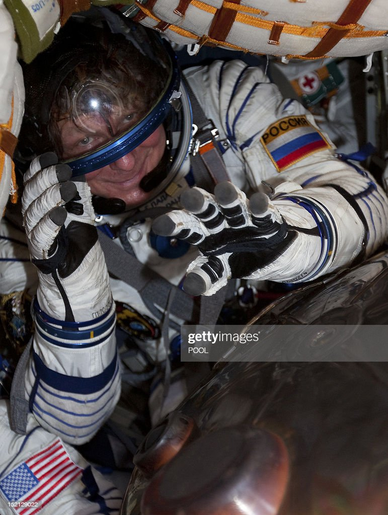 One of the International Space Station (ISS) crew members, Russian cosmonaut Gennady Padalka, sits inside the Soyuz TMA-04M capsule shortly after its landing near the town of Arkalyk in northern Kazakhstan, on September 17, 2012. A woman took today command of the ISS for only the second time as three US and Russian colleagues made a safe return from the orbiting space lab to the Kazakh steppe.