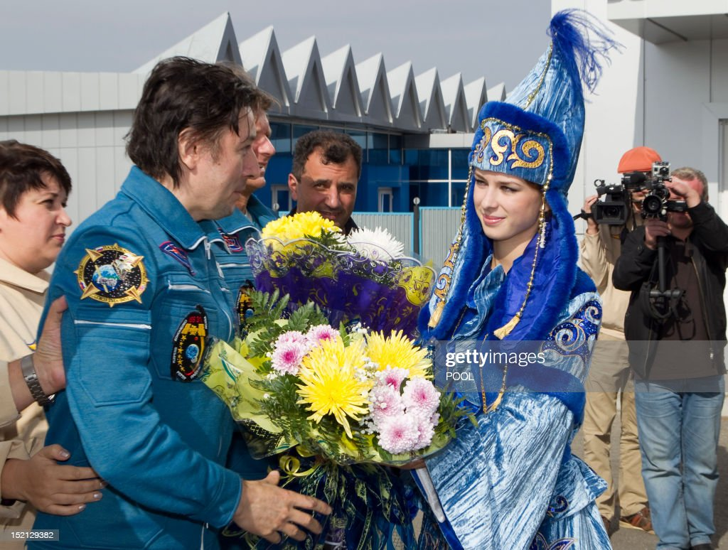 One of the International Space Station (ISS) crew members, Russian cosmonaut Sergei Revin (L), is welcomed on arrival to Kostanay after the crew landing in northern Kazakhstan, on September 17, 2012. A woman took today command of the ISS for only the second time as three US and Russian colleagues made a safe return from the orbiting space lab to the Kazakh steppe.
