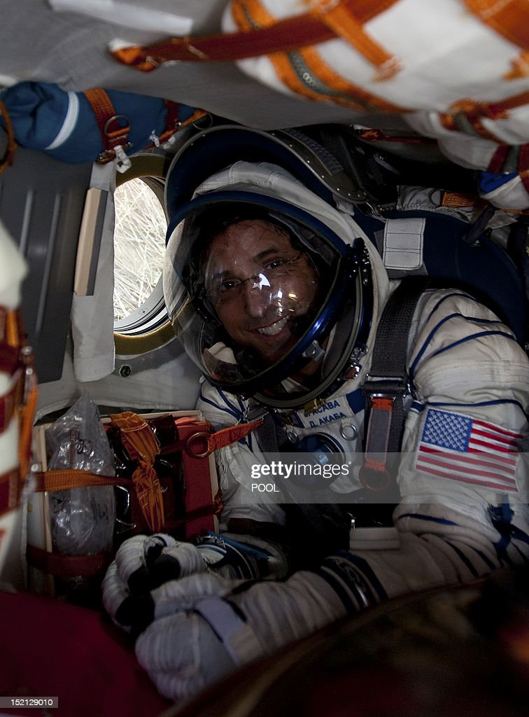 One of the International Space Station (ISS) crew members, US astronaut Joseph Acaba, sits inside the Soyuz TMA-04M capsule shortly after its landing near the town of Arkalyk in northern Kazakhstan, on September 17, 2012. A woman took today command of the ISS for only the second time as three US and Russian colleagues made a safe return from the orbiting space lab to the Kazakh steppe.