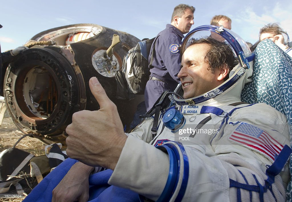 One of the International Space Station (ISS) crew members, US astronaut Joseph Acaba, gestures shortly after the landing near the town of Arkalyk in northern Kazakhstan, on September 17, 2012. A woman took today command of the ISS for only the second time as three US and Russian colleagues made a safe return from the orbiting space lab to the Kazakh steppe.