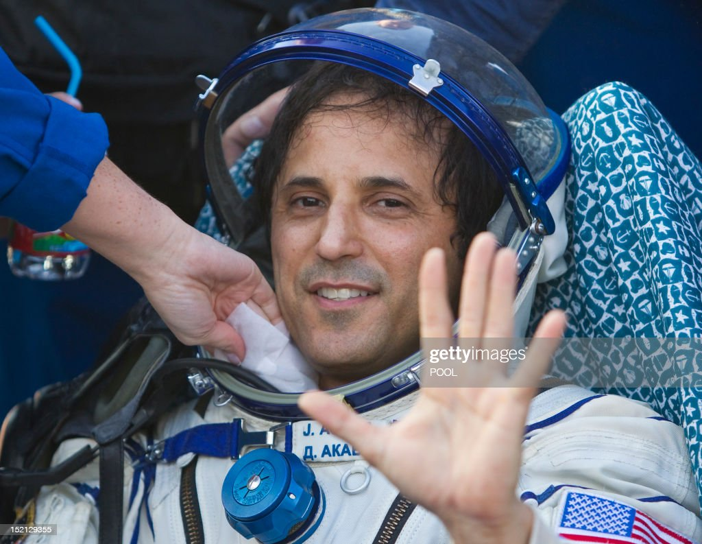 One of the International Space Station (ISS) crew members, US astronaut Joseph Acaba, waves shortly after the landing near the town of Arkalyk in northern Kazakhstan, on September 17, 2012. A woman took today command of the ISS for only the second time as three US and Russian colleagues made a safe return from the orbiting space lab to the Kazakh steppe.