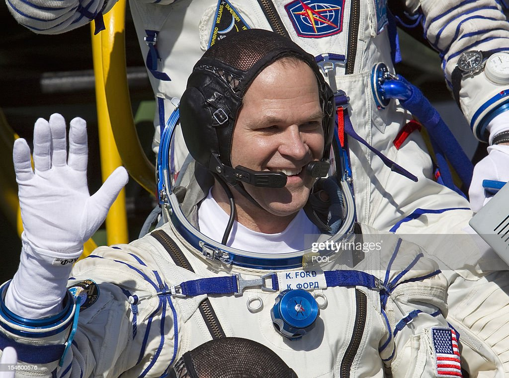 One of the International Space Station (ISS) crew members, US astronaut Kevin Ford waves as he boards the Soyuz TMA-06M spacecraft at the Russian leased Kazakhstan's Baikonur cosmodrome, on October 23, 2012, shortly before the launch of the crew, including Ford together with Russian cosmonauts Oleg Novitskiy and Evgeny Tarelkin. AFP PHOTO / POOL/ SHAMIL ZHUMATOV