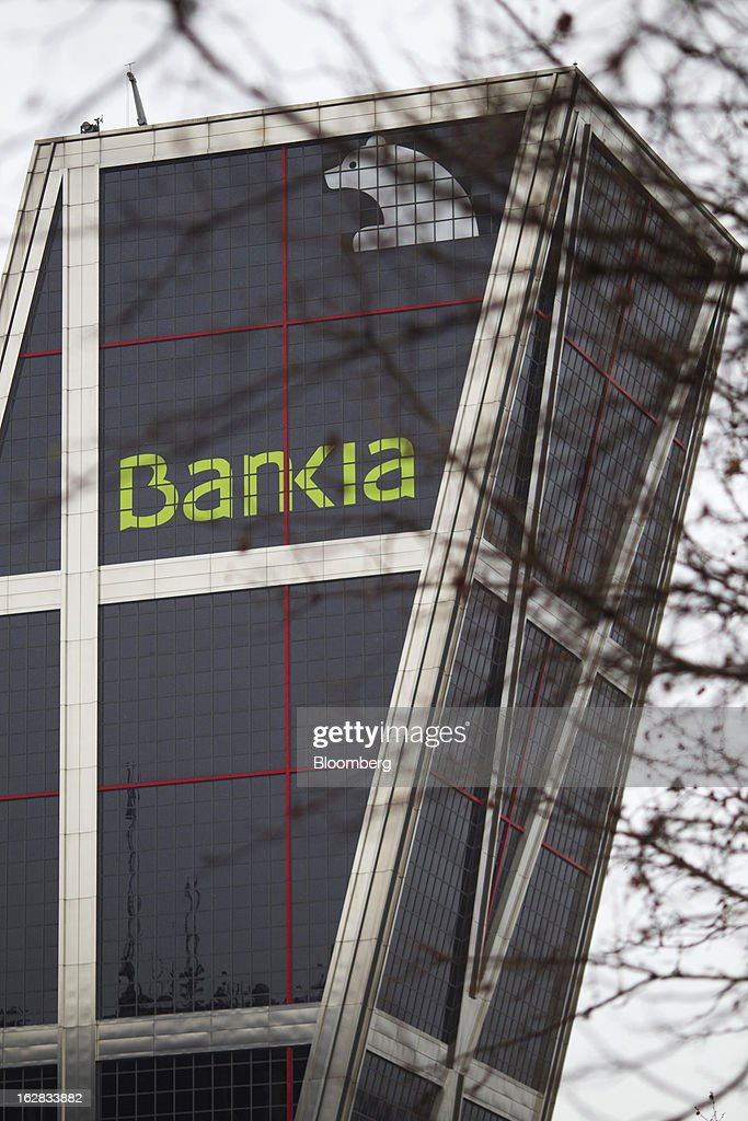 One of the Kio towers, headquarters of Bankia SA, stand in Madrid, Spain, on Thursday, Feb. 28, 2013. BFA-Bankia Chairman Jose Ignacio Goirigolzarri said a balance sheet clean-up that inflicted a 21.2 billion-euro ($27.6 billion) after-tax loss last year will set the Spanish banking group on course to repay state aid. Photographer: Angel Navarrete/Bloomberg via Getty Images