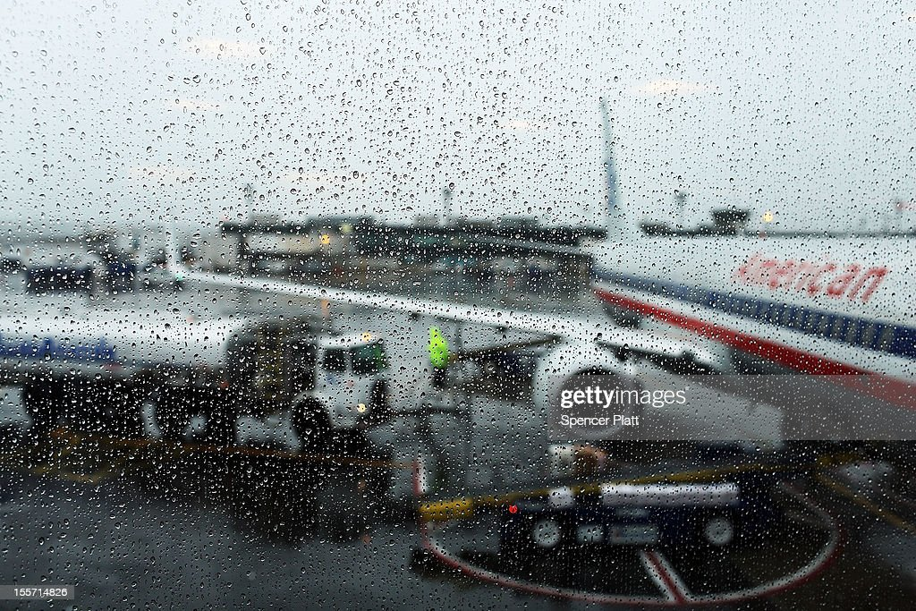 One of the last flights to leave after many were cancelled due to a storm is fueled up at LaGuardia Airport on November 7, 2012 in New York City. The Northeast suffered another storm today as a mix of snow, rain and high winds moved through the area, canceling flights and creating hazardous driving conditions. Six thousand households in the area are still without power for more than nine days following Superstorm Sandy.