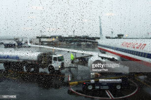 One of the last flights to leave after many were cancelled due to a storm is fueled up at LaGuardia Airport on November 7 2012 in New York City The...
