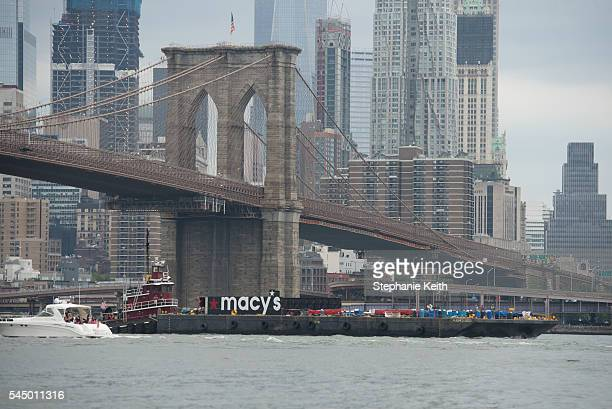 One of the Macy's barges passes under the Brooklyn Bridge before the Macy's Fourth of July Fireworks from Brooklyn Bridge Park on July 4 2016 in the...