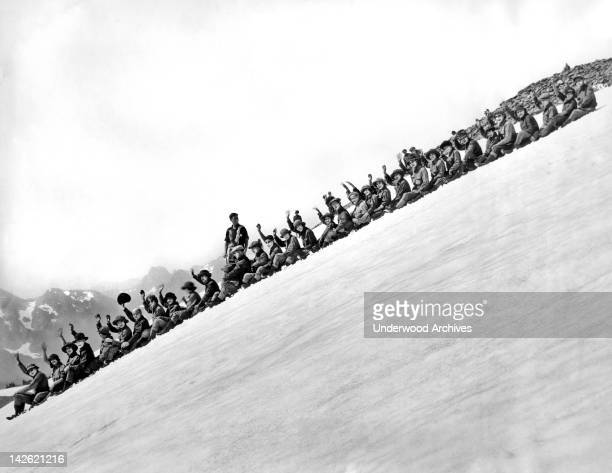 One of the main summer snow amusements at Rainier National Park Rainier National Park Washington late 1920s or early 1930s The participants are given...