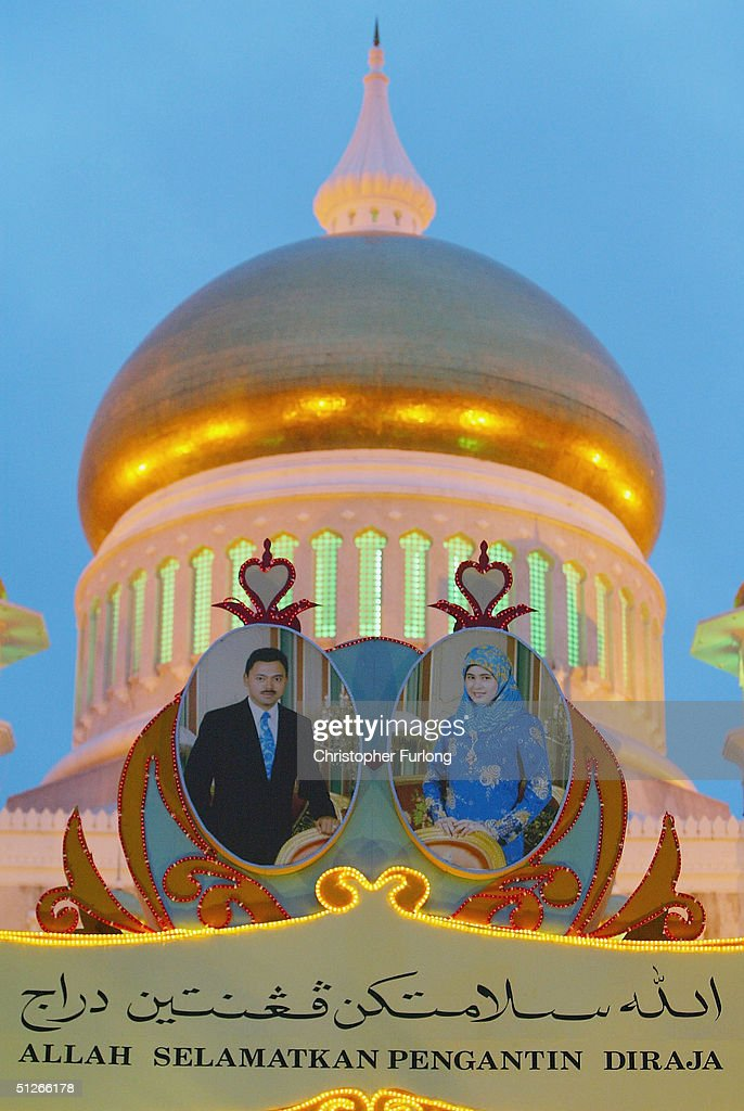 BEGAWAN , BRUNEI - SEPTEMBER 6. One of the many illuminated and colourful wedding arches depicting the royal wedding couple that adorn the city in preparation for the royal procession, September 6, 2004, Bandar Seri Begawan, Brunei. The people of Brunei are gearing up for the culmination of the wedding of, His Royal Highness Prince Haji Al-Muhtadee Billah ibni Sultan Haji Hassanal Bolkiah Mu?izzaddin Waddaulah, the Crown Prince of Brunei Darussalam and his bride Princess Dayangku Sarah binti Pengiran Salleh Ab Rahaman