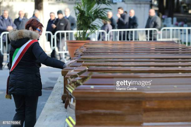 One of the mayors of Salernitan communes pays homage to the coffins during the funeral of the 28 migrant women who died in a shipwreck as they sought...