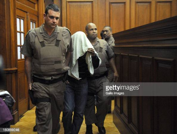 One of the men accused of murdering tourist Anni Dewani Xolile Mngeni appears in the Western Cape High Court on August 27 2012 in Cape Town South...