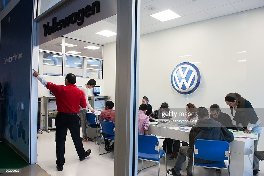 One of the most difficult decisions of the day is what type of car to buy. Students gather in the volkswagen storefront to make the big decision. Eighth graders in Fairfax participate in a financial literacy program where they attend the Junior Achievement Financial Academy, run in partnership with Capital One Bank. At the academy, the students are given real-life exercises about mortgages, paying bills, applying for credit. On this day students from Holmes Middle School attend the academy.