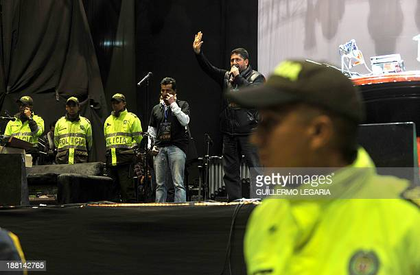 One of the organizers accompanied on stage by police officers announces that Argentine's musician Charly Garcia had taken ill on his way to the...