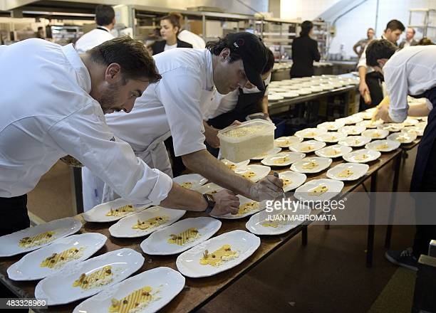 One of the owners of Spanish restaurant 'El Celler de Can Roca' patissier Jordi Roca supervises the preparation of a dish at the kitchen of the...