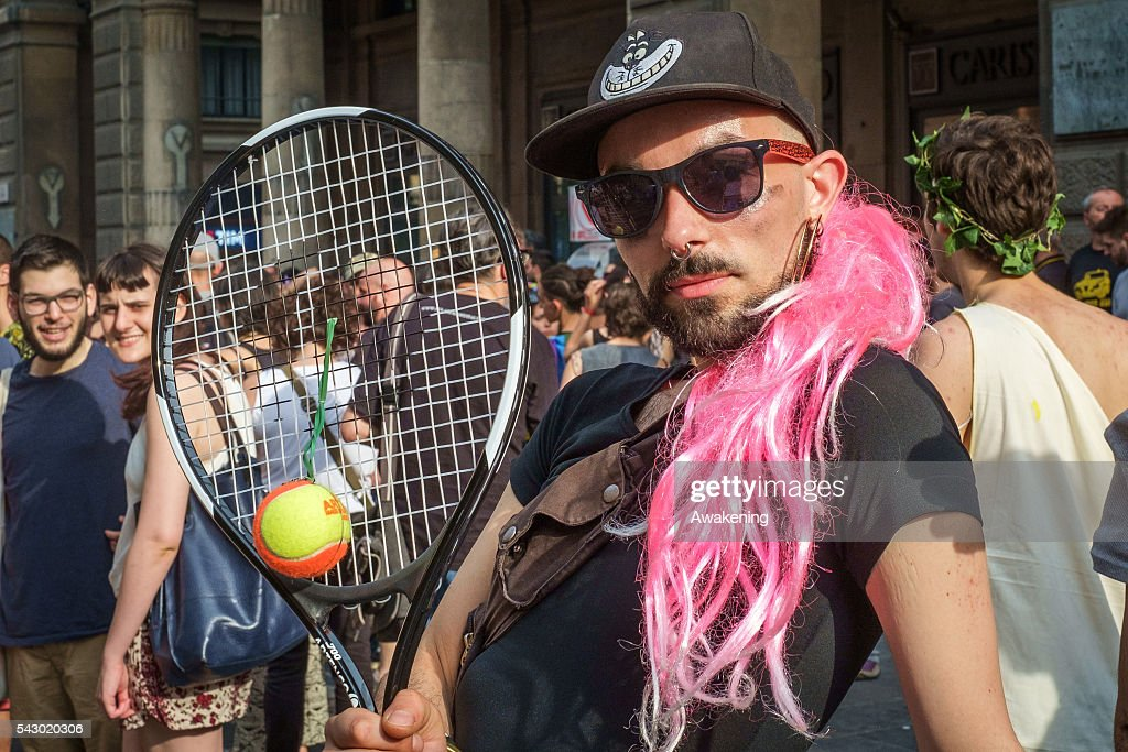 One of the participants to the Gay Pride Bologna dance with a tennis racket in hand on June 25, 2016 in Bologna, Italy. The parade is part of a World Pride Week and attracted thousands of marchers fighting for gay rights. 2016 Pride comes just two weeks after Omar Mateen shot dead 50 people at Pulse, a gay nightclub in Orlando, Florida.