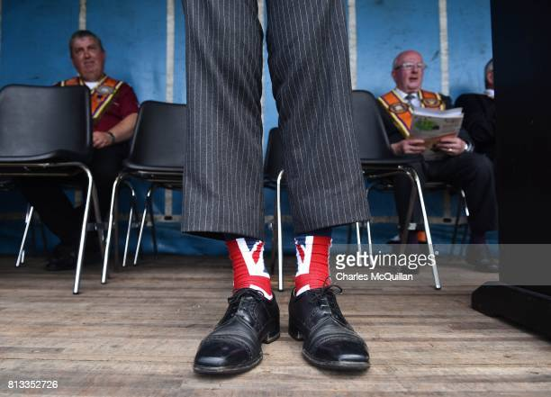 One of the platform party displays his Union Jack socks as the Independent Orange Lodge holds its annual parade on July 12 2017 in Rasharkin Northern...