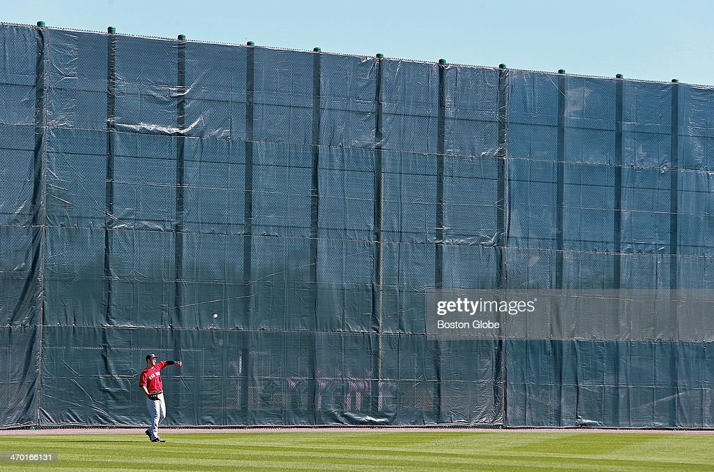 One of the practice fields has a giant wall, meant to replicate the height of Fenway Park's Green Monster, and it dwarfs outfielder Grady Sizemore. The Boston Red Sox held their first official spring training workout in Fort Myers, Fla., Feb. 17, 2014.