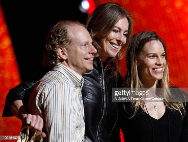 APPLY*** One of the Producer's of this year's Oscar ceremony Bruce Cohen poses for a photo with Kathryn Bigelow and Hilary Swank as they rehearse...