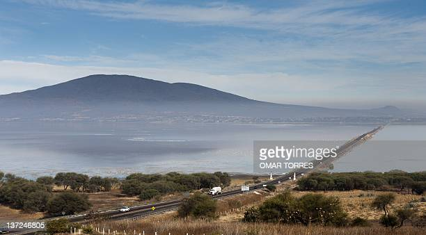 One of the roads that crosses the Cuitzeo lagoon is seen on January 13 2012 in Michoacan state Mexico The local fishermen presently have their...