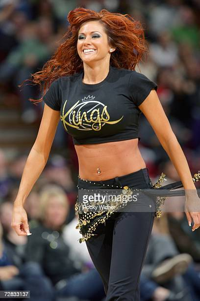 One of the Sacramento Kings Dance Team performs during a break in the NBA game between the Atlanta Hawks and the Sacramento Kings at Arco Arena on...
