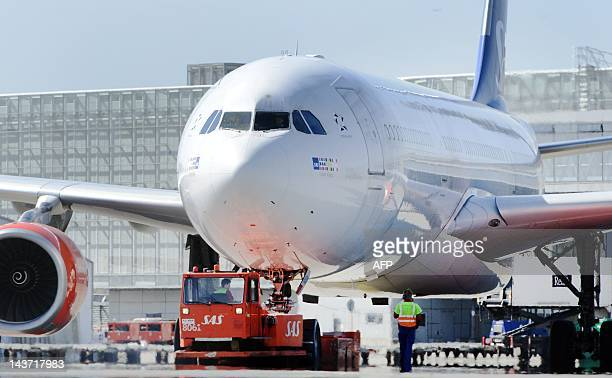 One of the SAS' Airbus A330300 aircrafts is prepared for a flight to the US from Stockholm Arlanda airport in Sweden on May 3 2012 Scandinavian...