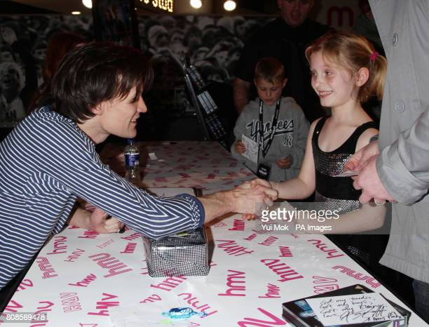 One of the stars of the show Matt Smith with Eleanor Maddocks aged 7 from Brighton after she presented him with a present during an instore signing...
