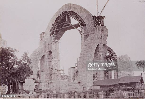 One of the stone arches of the Cathedral of St John the Divine in New York City during one of its early phases of construction ca 1900