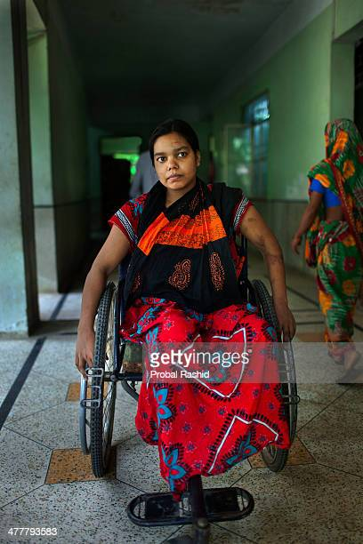one of the survivors of the Rana Plaza building collapse sits on a wheelchair because she lost both of her legs in a hospital at Savar During the...