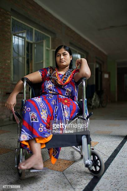 one of the survivors of the Rana Plaza building collapse sits on a wheelchair because she lost one of her legs in a hospital at Savar During the...