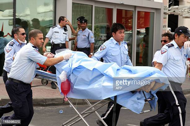 One of the survivors recieves medical care outside Doha's Villaggio Mall after a fire broke out inside the Gulf emirate's upscale shopping centre on...