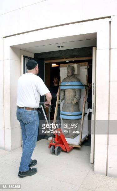 One of the Terracotta Warriors from The First Emperor China's Terracotta Army exhibition at the British Museum is taken away to be shipped back to...