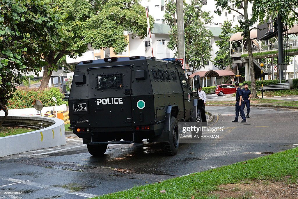 One of the three armoured vehicle transporting six arrested Bangladeshi guest workers arrives to the State court in Singapore on May 31, 2016. The six Bangladeshi guest workers will be convicted and sentence for raising funds for an alleged plot to launch terrorist attacks in their homeland. / AFP / ROSLAN