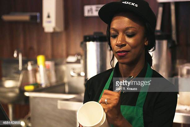 One of the two baristas working inside of Dumb Starbucks marks a cup in the Los Feliz neighborhood on February 10 2014 in Los Angeles California The...