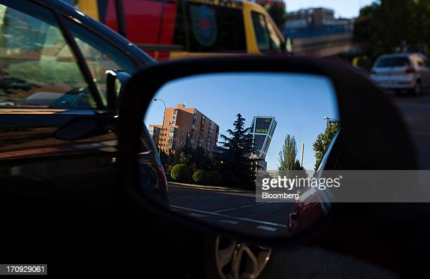 One of the two KIO Towers headquarters of Bankia SA is reflected in an automobile's wing mirror in Madrid Spain on Thursday June 20 2013 Bailing out...