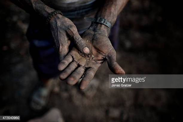One of the workers at a coal mines in Jharia rolls chewing tobacco in his dirty hand Jharia in India's eastern Jharkand state is literally in flames...