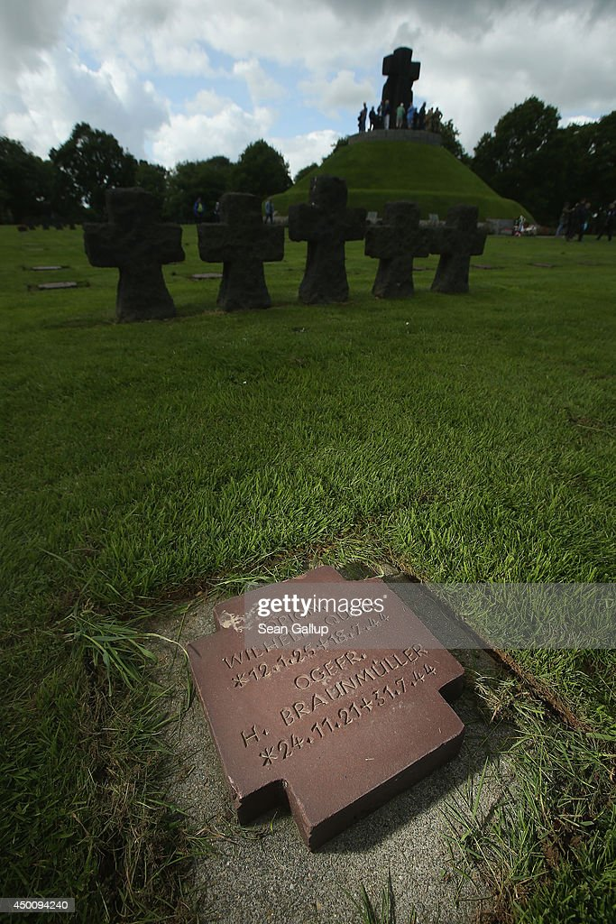 One of thousands of gravestones lies at the German Cemetery where approximately 21,000 German World War II soldiers are buried on June 5, 2014 at La Cambe, France. Friday the 6th of June is the 70th anniversary of the D-Day landings that saw 156,000 troops from the Allied countries, including the United Kingdom and the United States, join forces to launch an audacious attack on the beaches of Normandy, these assaults are credited with the eventual defeat of Nazi Germany. A series of events commemorating the 70th anniversary are planned for the week with many heads of state travelling to the famous beaches to pay their respects to those who lost their lives.