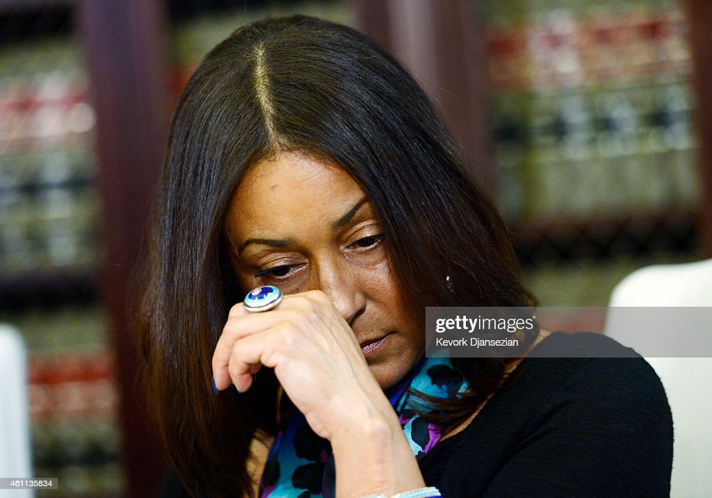 One of three alleged victims of sexual abuse by comedian Bill Cosby using the assumed name Kacey react during a news conference with attorney Gloria...