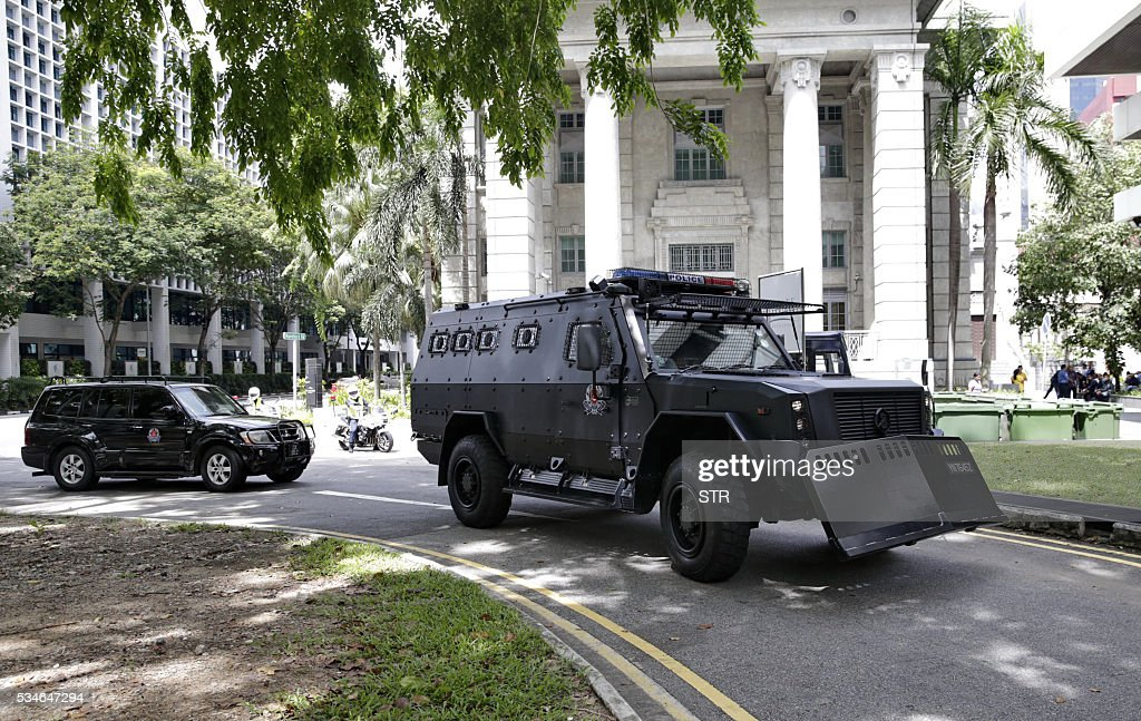 One of three armoured personnel carriers (front) from the Singapore police task force escorting six arrested Bangladeshi guest workers arrives at the State court in Singapore on May 27, 2016. Singapore on May 27 charged six Bangladeshi guest workers with raising funds for an alleged plot to launch terrorist attacks in their homeland. / AFP / STR / Singapore OUT