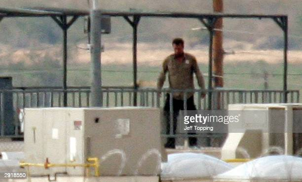 One of two inmates holding a hostage at the State Prison ComplexLewis walks on the observation deck of a guard tower wearing a guard's shirt January...