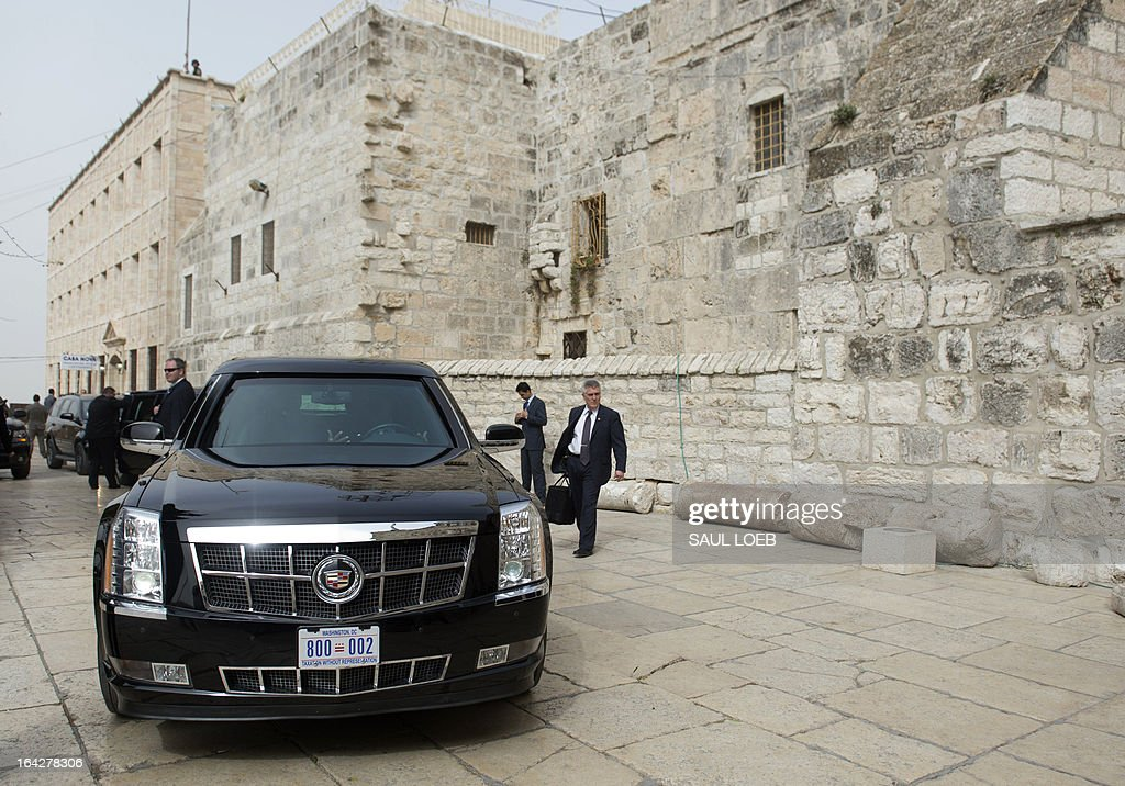 One of US President Barack Obama's limousines is seen parked outside the Church of the Nativity, the traditional birthplace of Jesus Christ, in the West Bank city of Bethlehem, on March 22, 2013, on the final day of Obama's 3-day trip to Israel and the Palestinian territories. AFP PHOTO / Saul LOEB