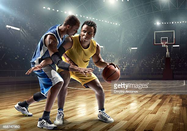 One on one basketball game in the spotlight